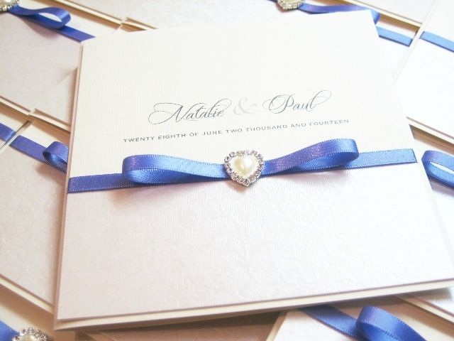 Invitation with heart pearl and lilac ribbon
