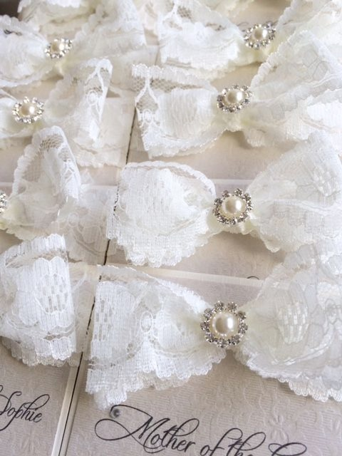Lace place name cards with pearl and lacey bow