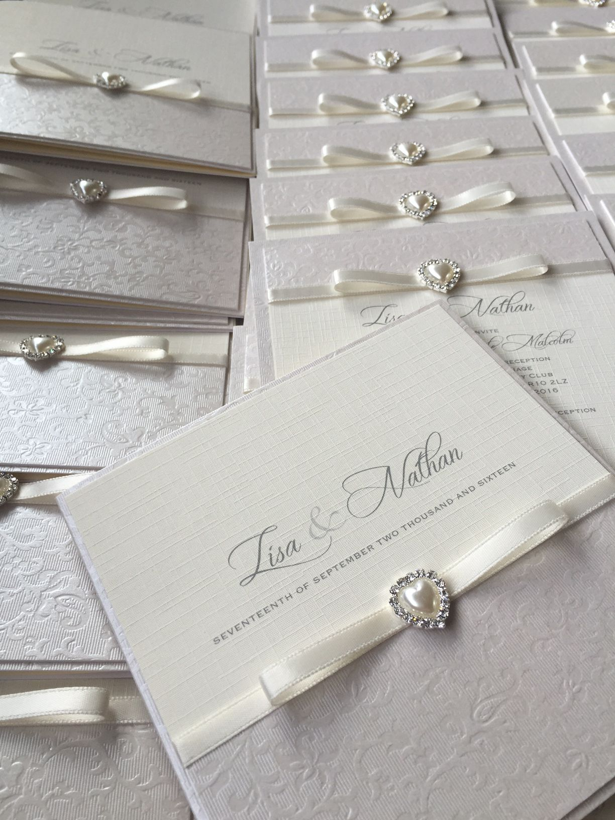 luxury ivory invitations with small pearl embellishment