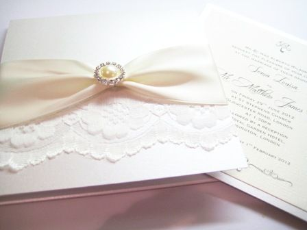 Lace invitations with pearl brooch