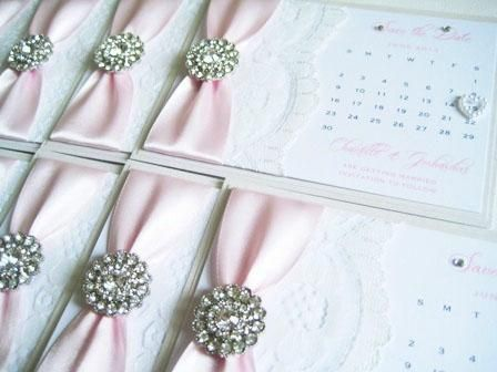 pale pink save the date cards with diamante brooch and lace