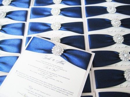 postcard style invitations with navy blue ribbon and vintage diamante brooch