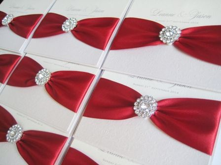 Red wedding invitations with crystal brooch