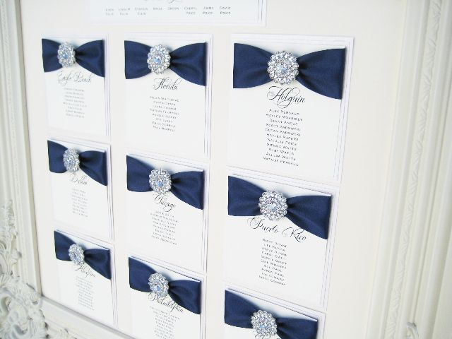 Framed seating plan with crystal vintage brooch