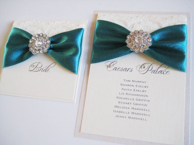 teal wedding stationery with lace and diamante brooch