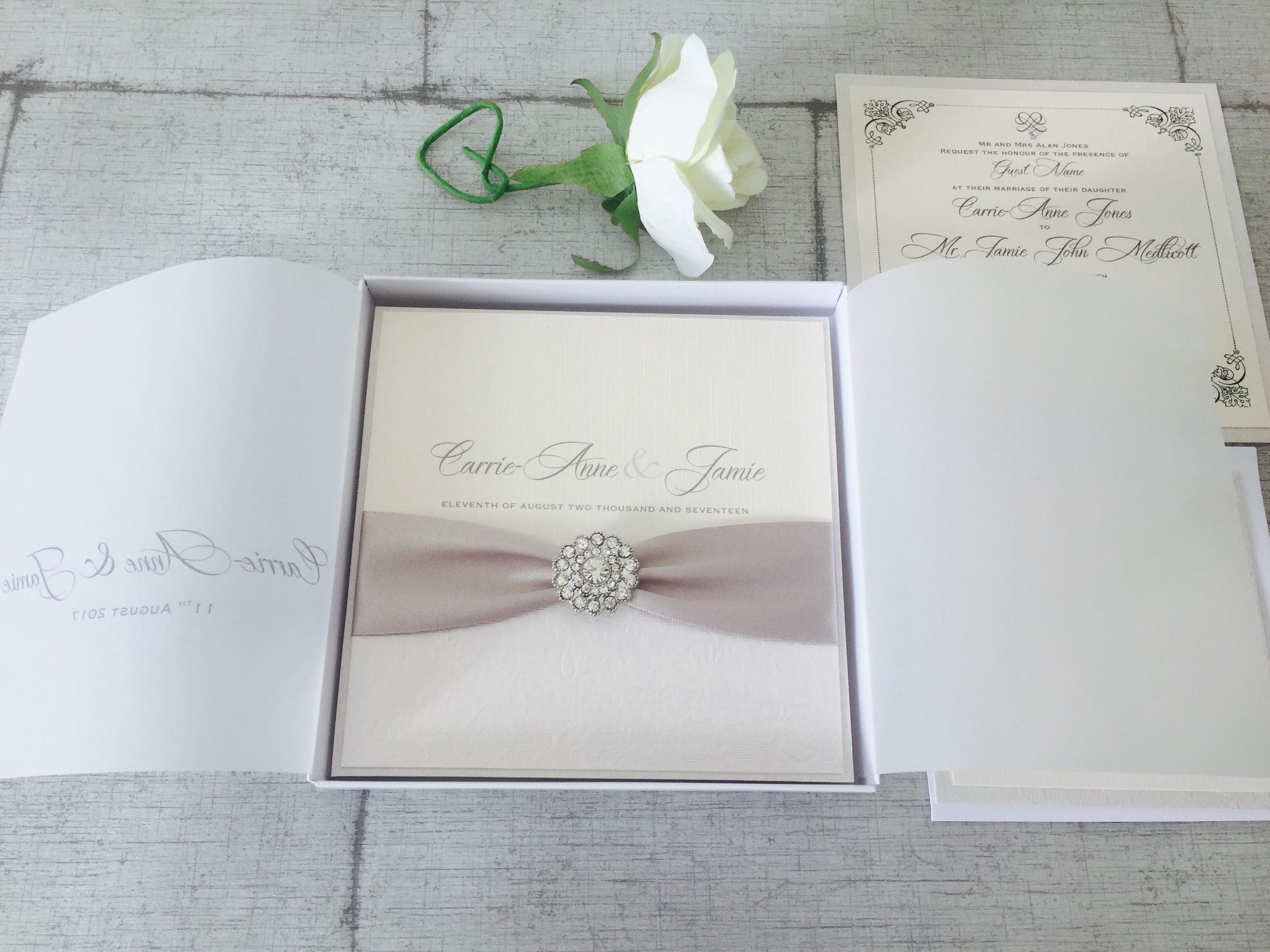 Modern romantic wedding invitations in ivory and silver