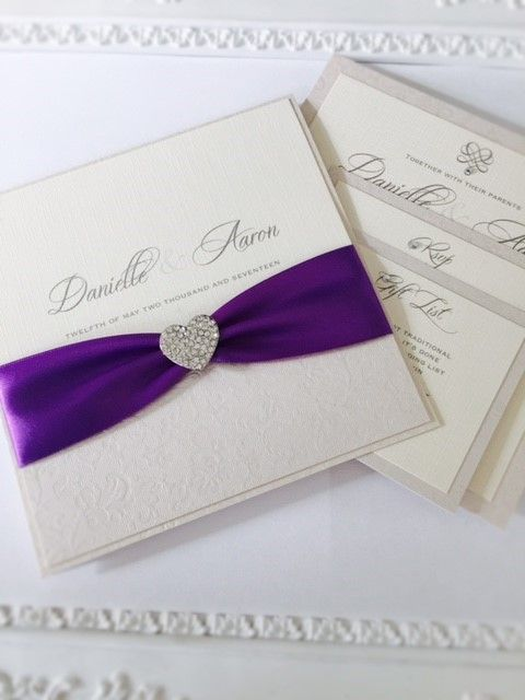 ivory pocket style invitation with modern diamante brooch