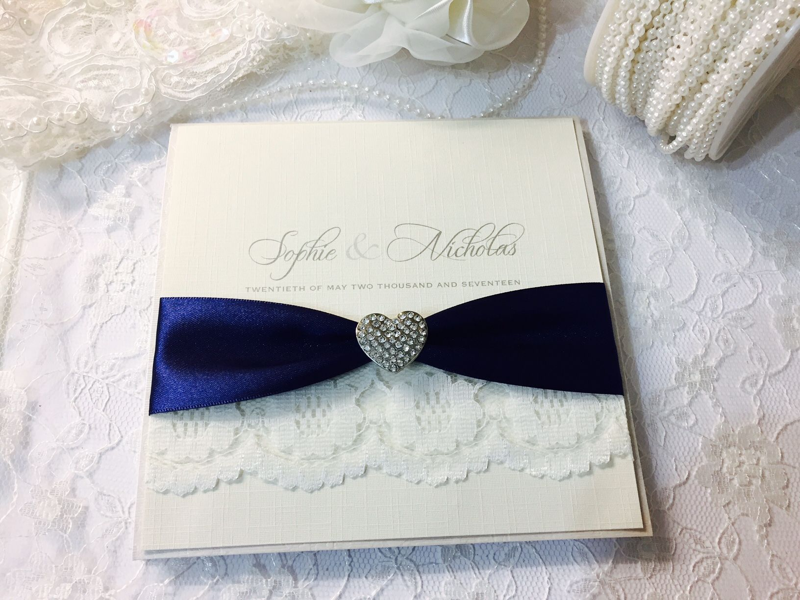 Lace and hearts invitation with diamante heart shaped brooch