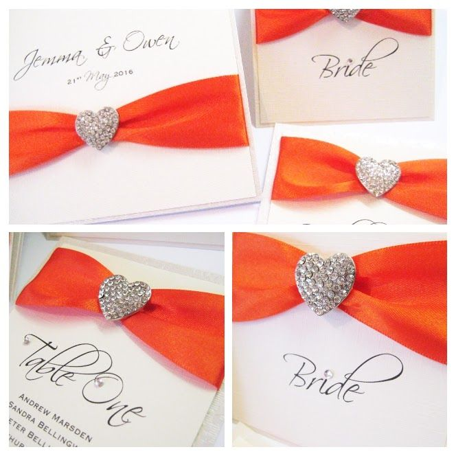 Ivory and orange invitations with diamante heart brooch