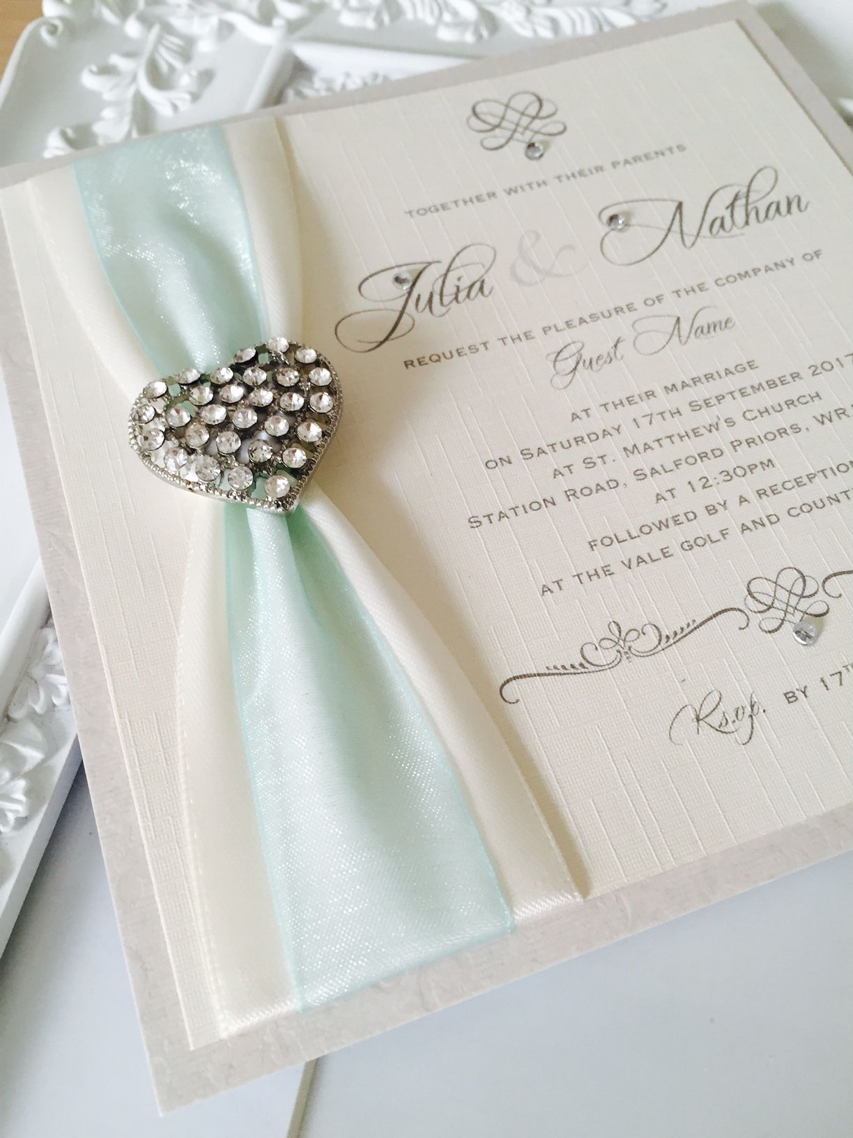Vintage style invitation with ivory and aqua ribbon decorated with vintage heart shaped brooch