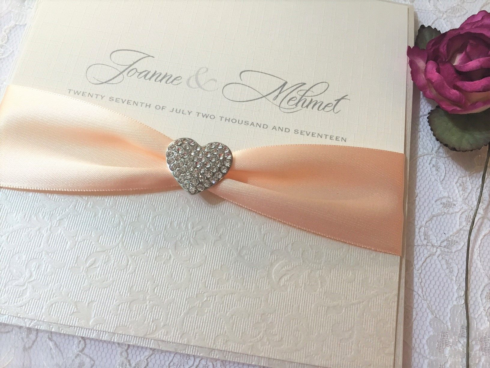 Ivory and peach invitation with diamante heart brooch