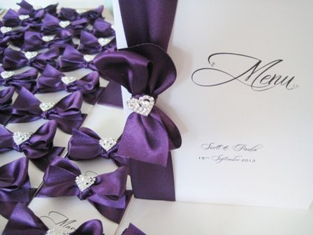 Wedding breakfast menu with cadburys purple ribbon and diamante brooch