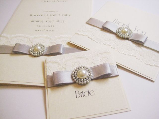 Silver and ivory vintage retro style invitations with pearl brooch