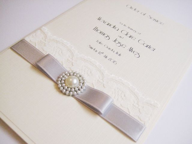 Order of service with silver ribbon made on ivory linen card