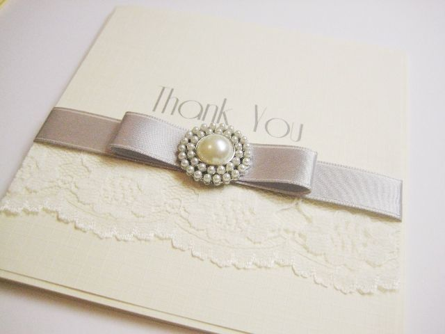 Lace thank you wedding card with silver ribbon and brooch