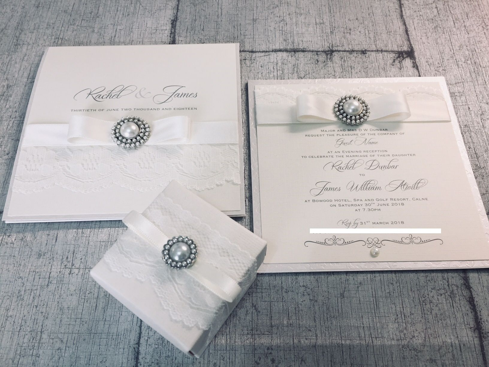 Day and evening invitation with lace and pearl brooch