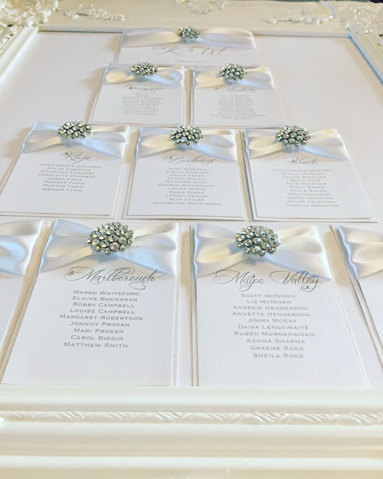 Beautiful seating plan with ribbon and diamante brooch