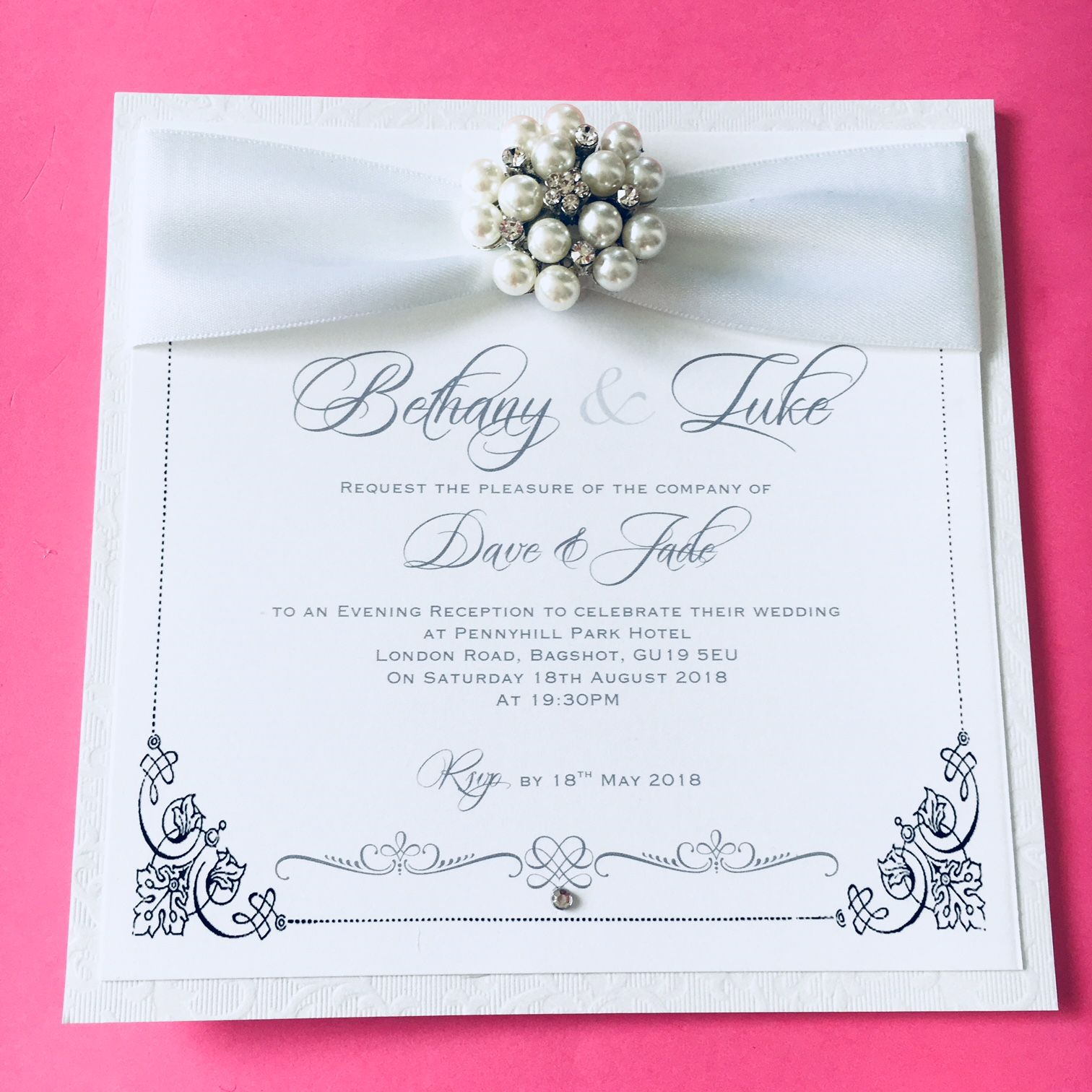 evening invitation with pearl brooch