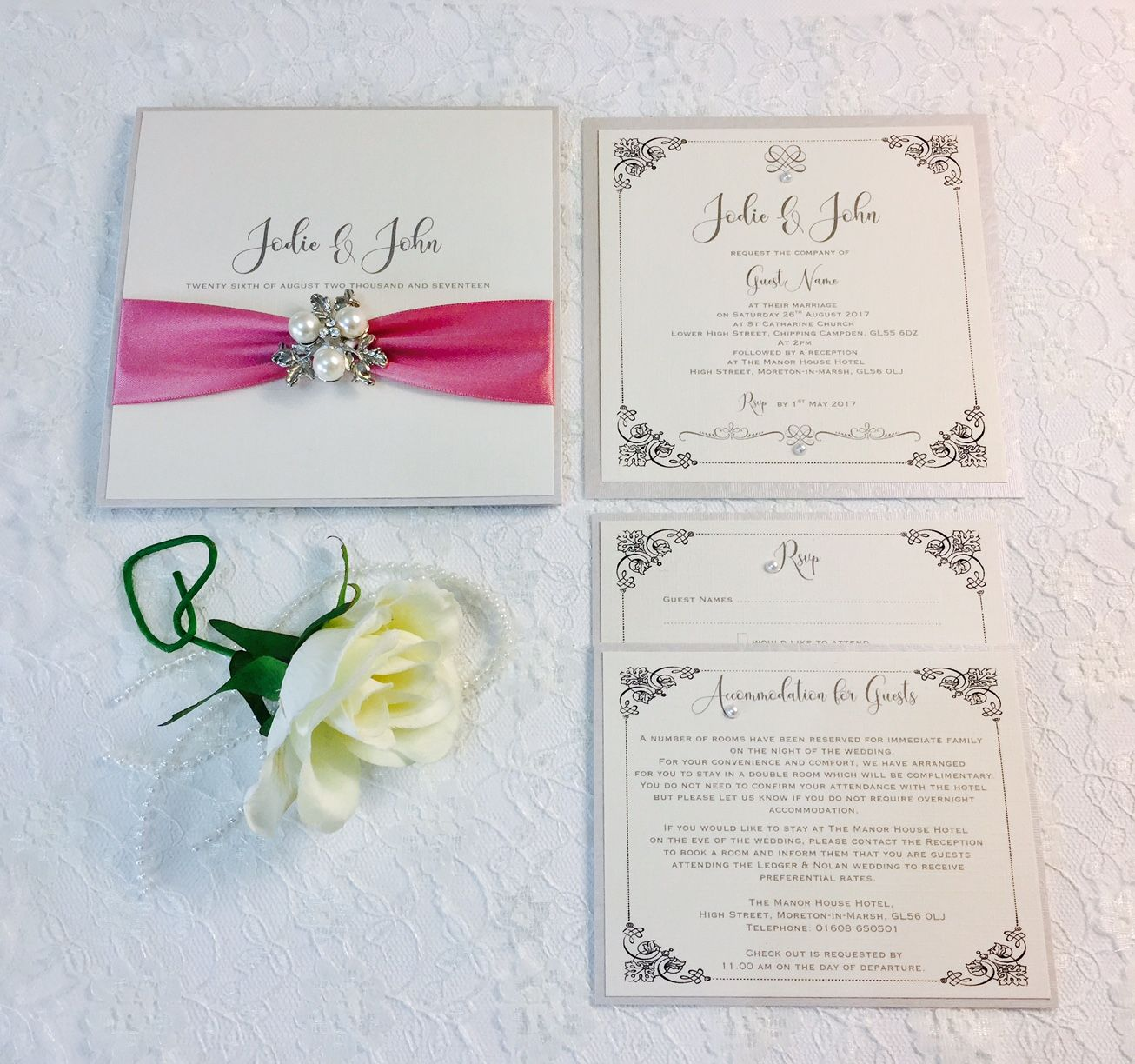 Luxury pocket style invitation with dusky pink ribbon and brooch