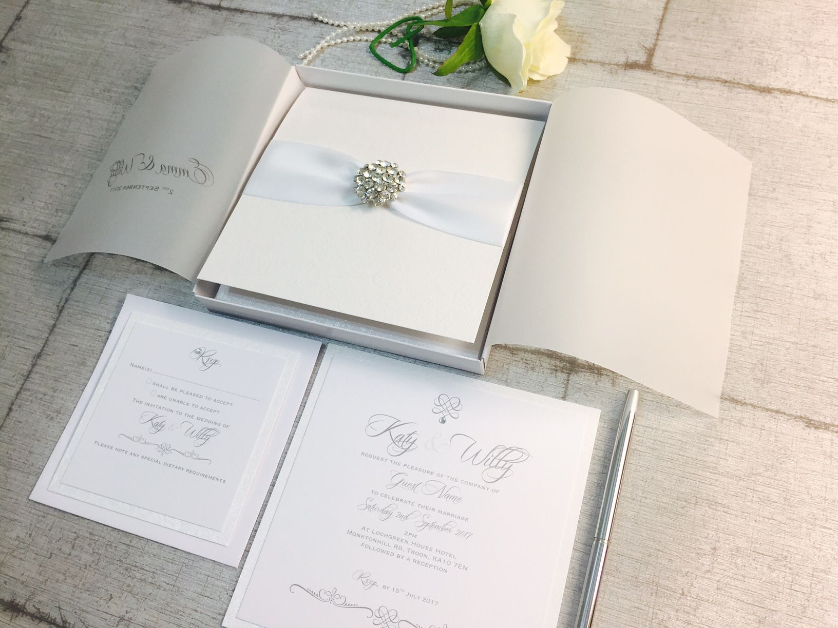 luxury white wedding invitations with diamante