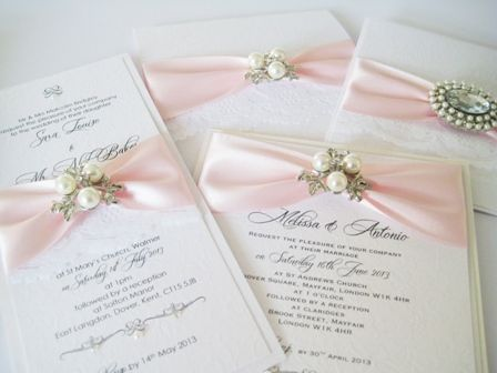 Beautiful boxed wedding invitations with pearl brooch