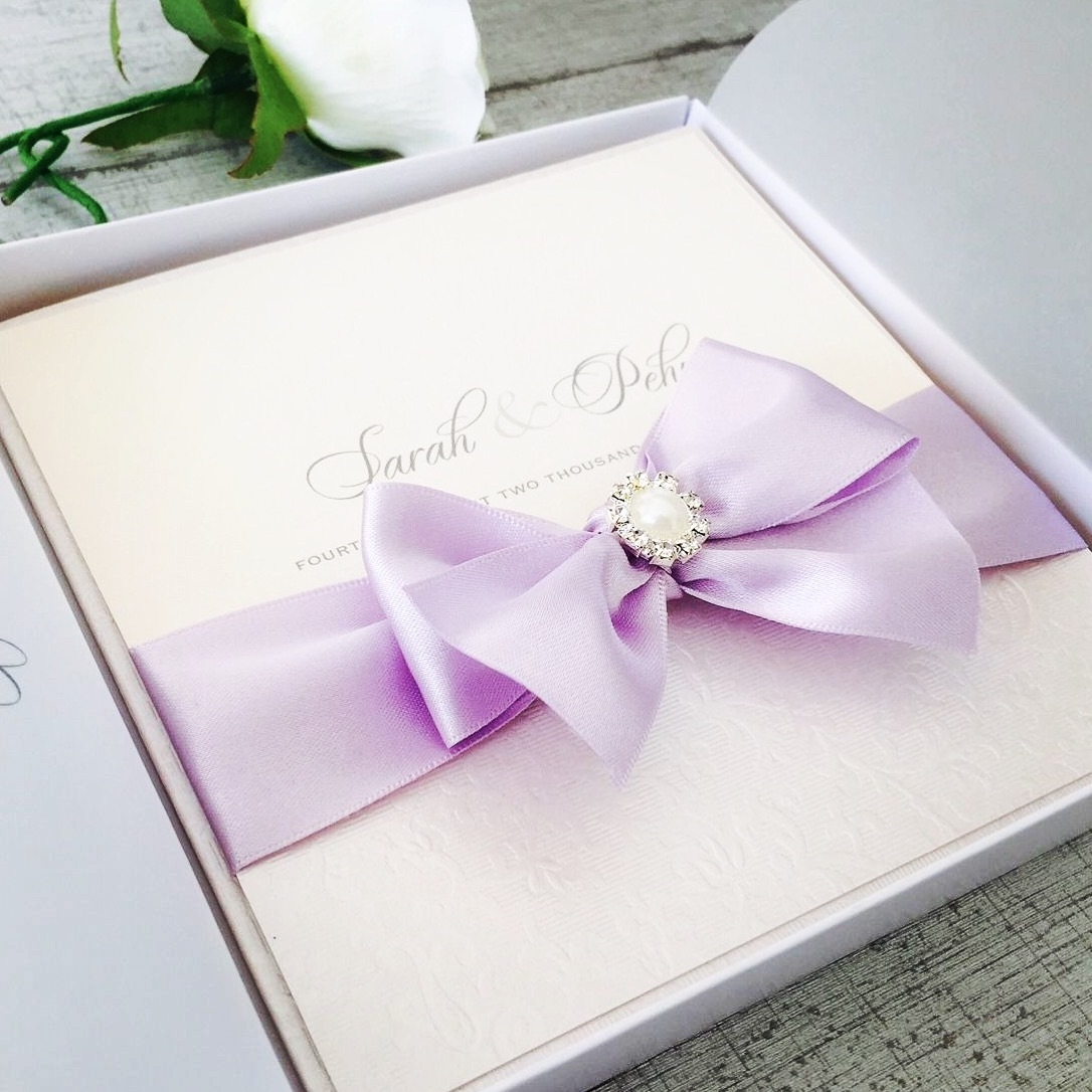 Boxed invitation with big bow