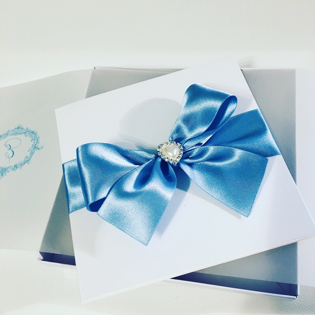 boxed wedding invitation with big bow and pearl heart