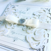 Laser Cut Wedding Invitation Sample with Bow and Crystal Brooch