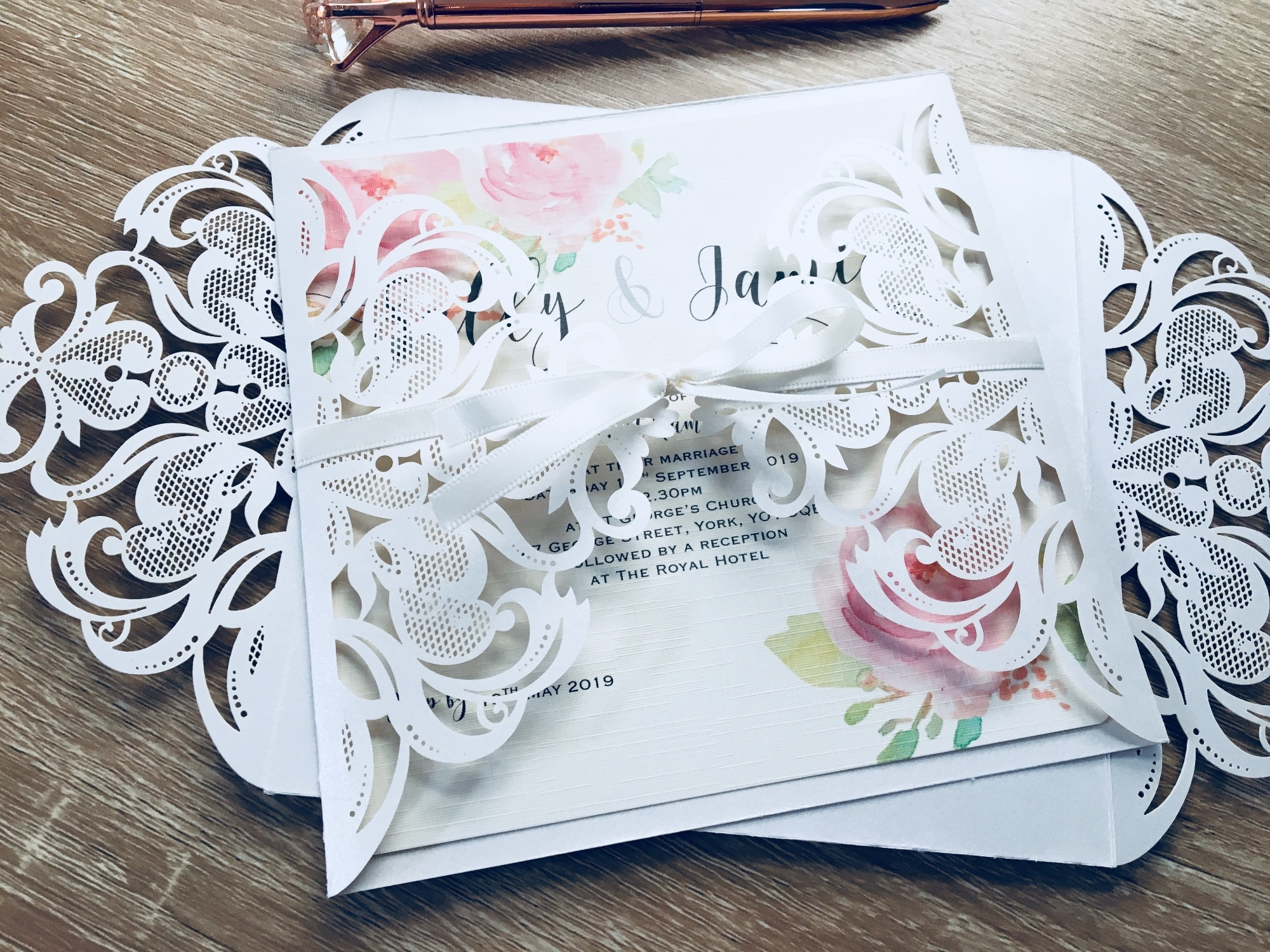 Laser cut invitation with pink rose inserts