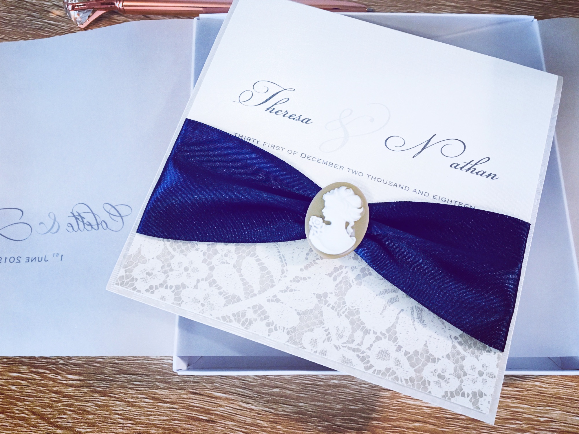 Cameo wedding invitation in ivory with cameo brooch