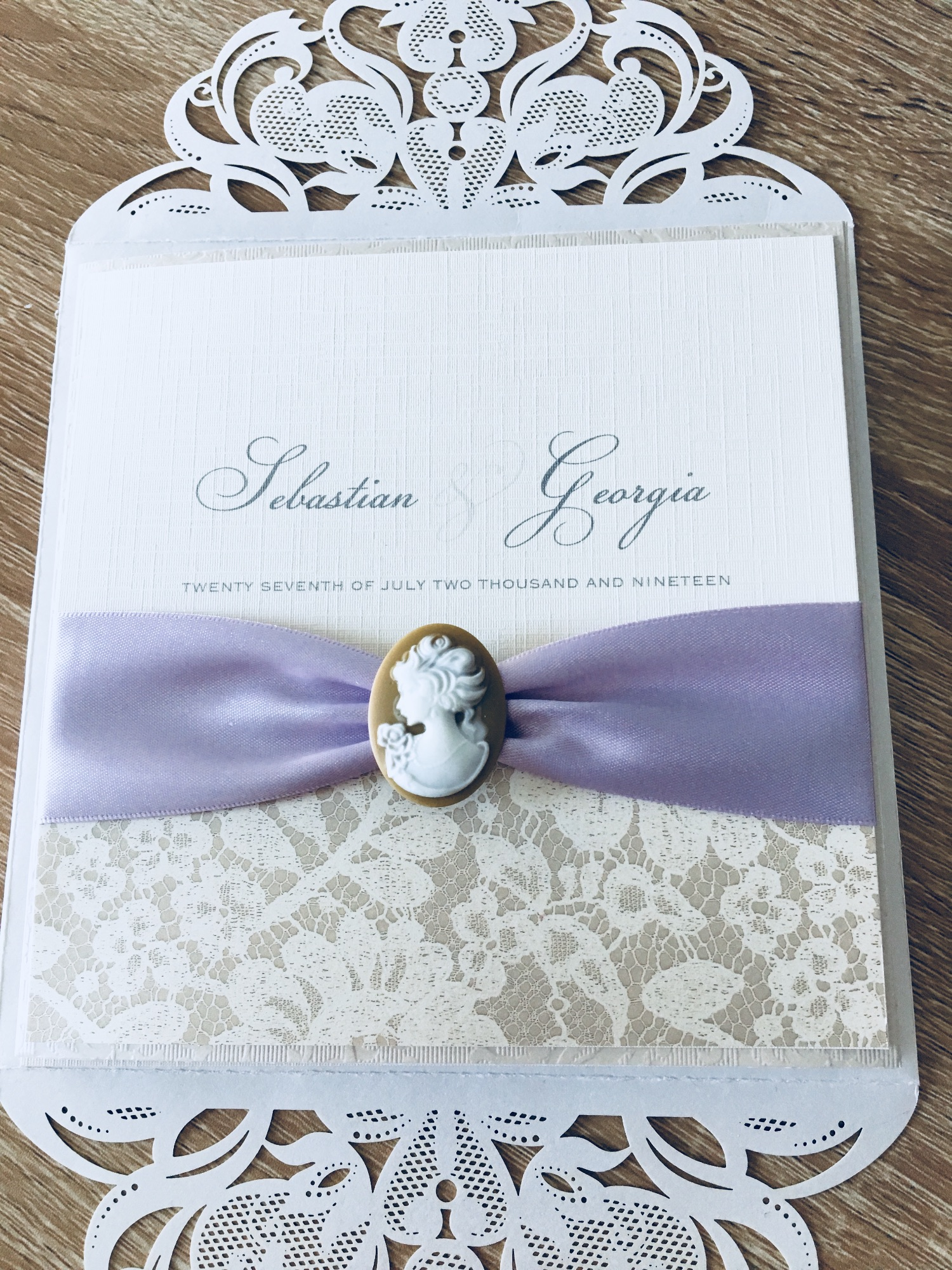 Cameo wedding invitation with lilac ribbon