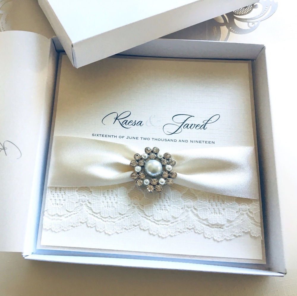 Ivory wedding invitation in box with Lace and brooch