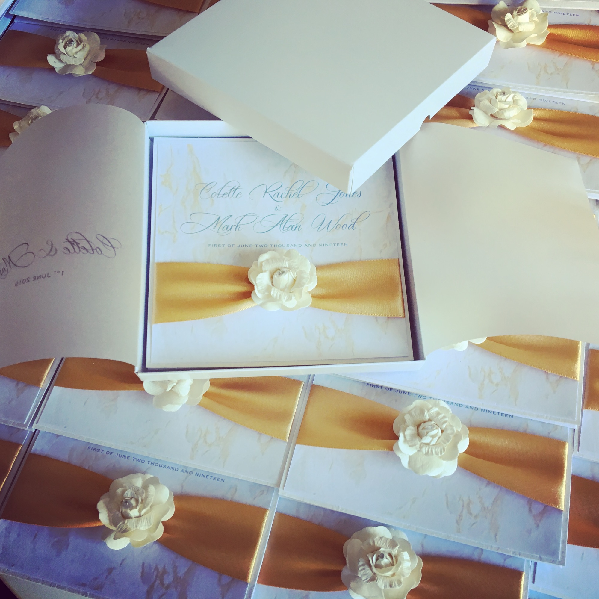 boxed marble wedding invitations with gold ribbon and ivory paper rose