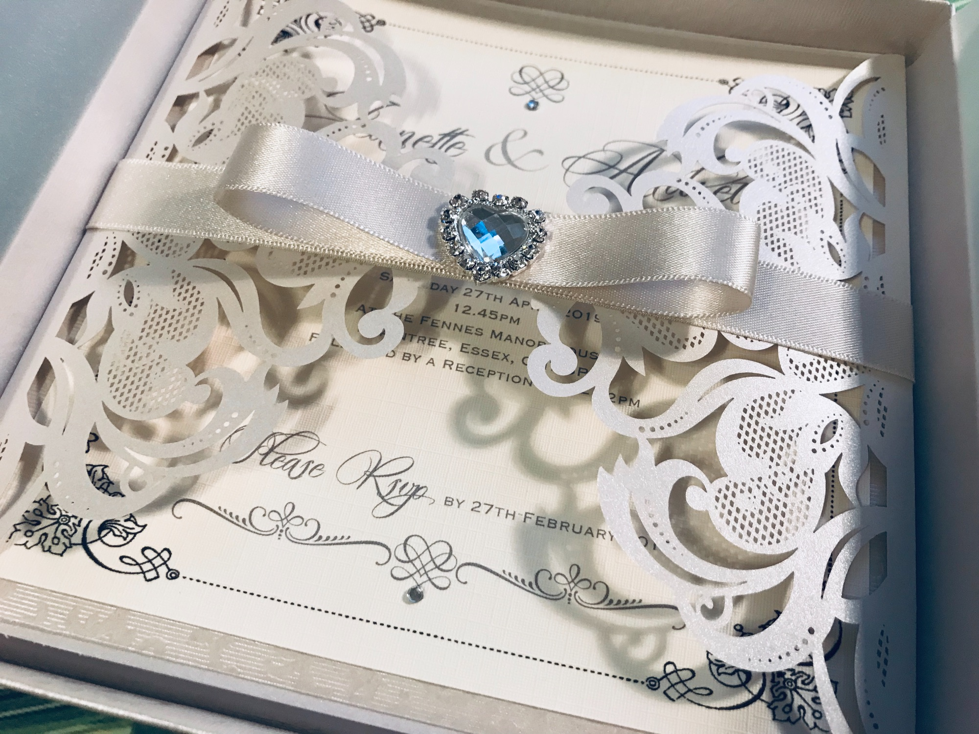 Laser cut boxed wedding invitation in ivory champagne colour