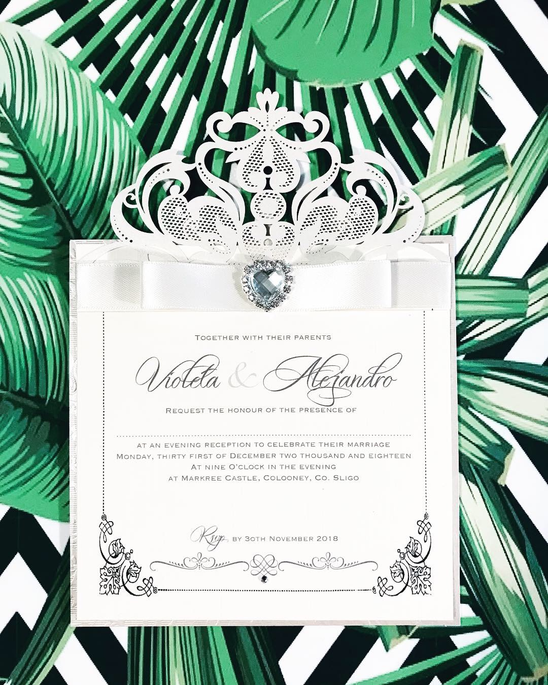 Laser cut evening invitations with crystal heart