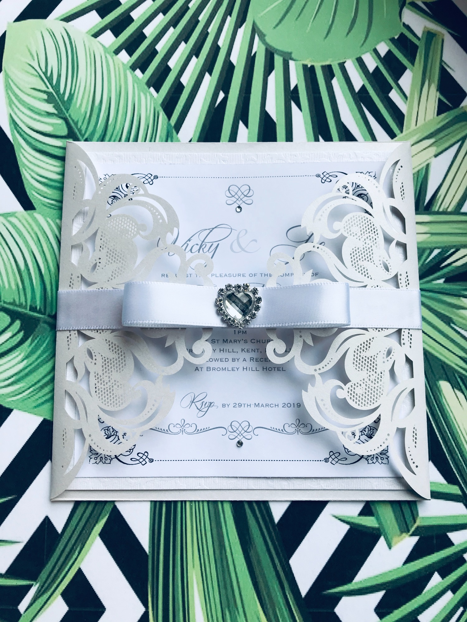 laser cut with white bow and crystal heart wrap