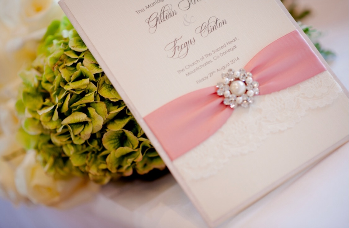 Wedding breakfast menu with brooch and lace