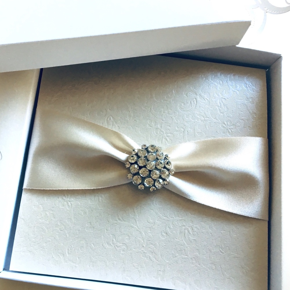 Crystal wedding invitation with champagne ivory ribbon