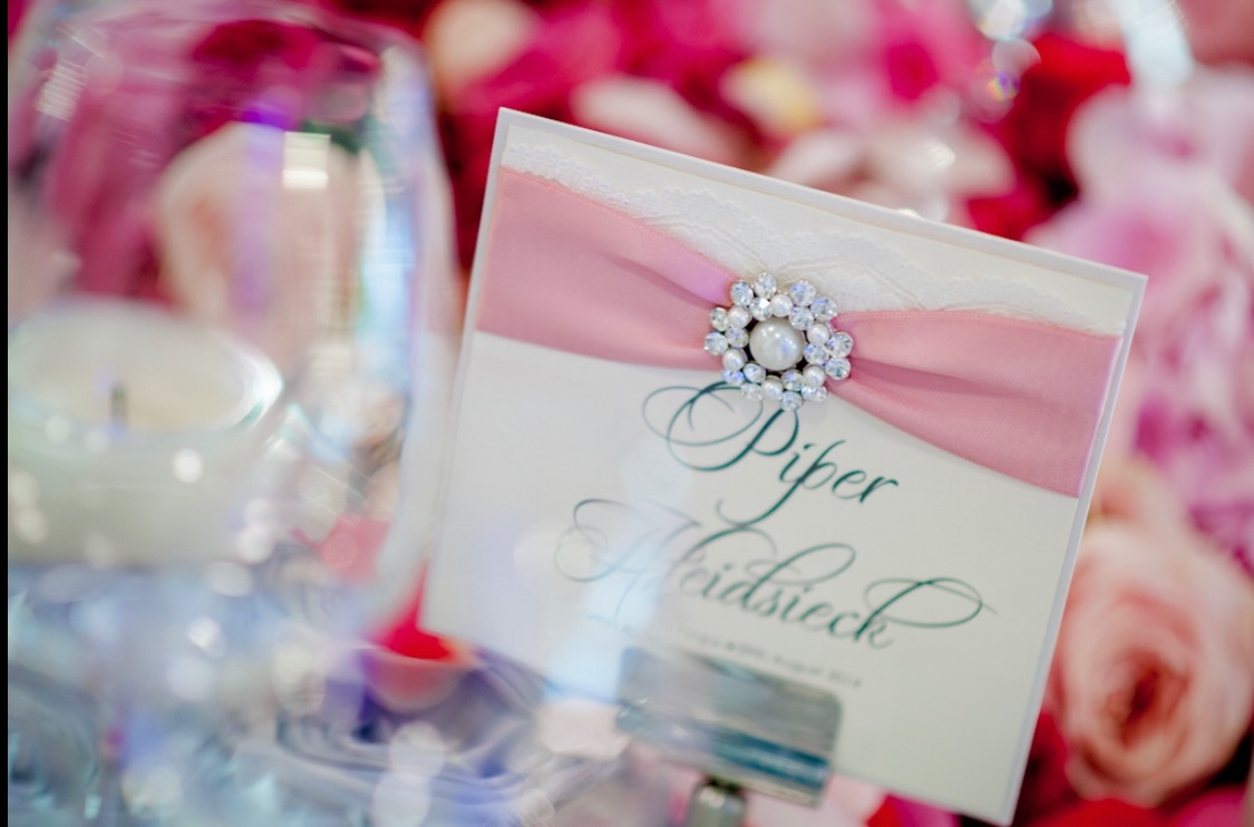 Luxury name cards for seating plan with brooch and ribbon