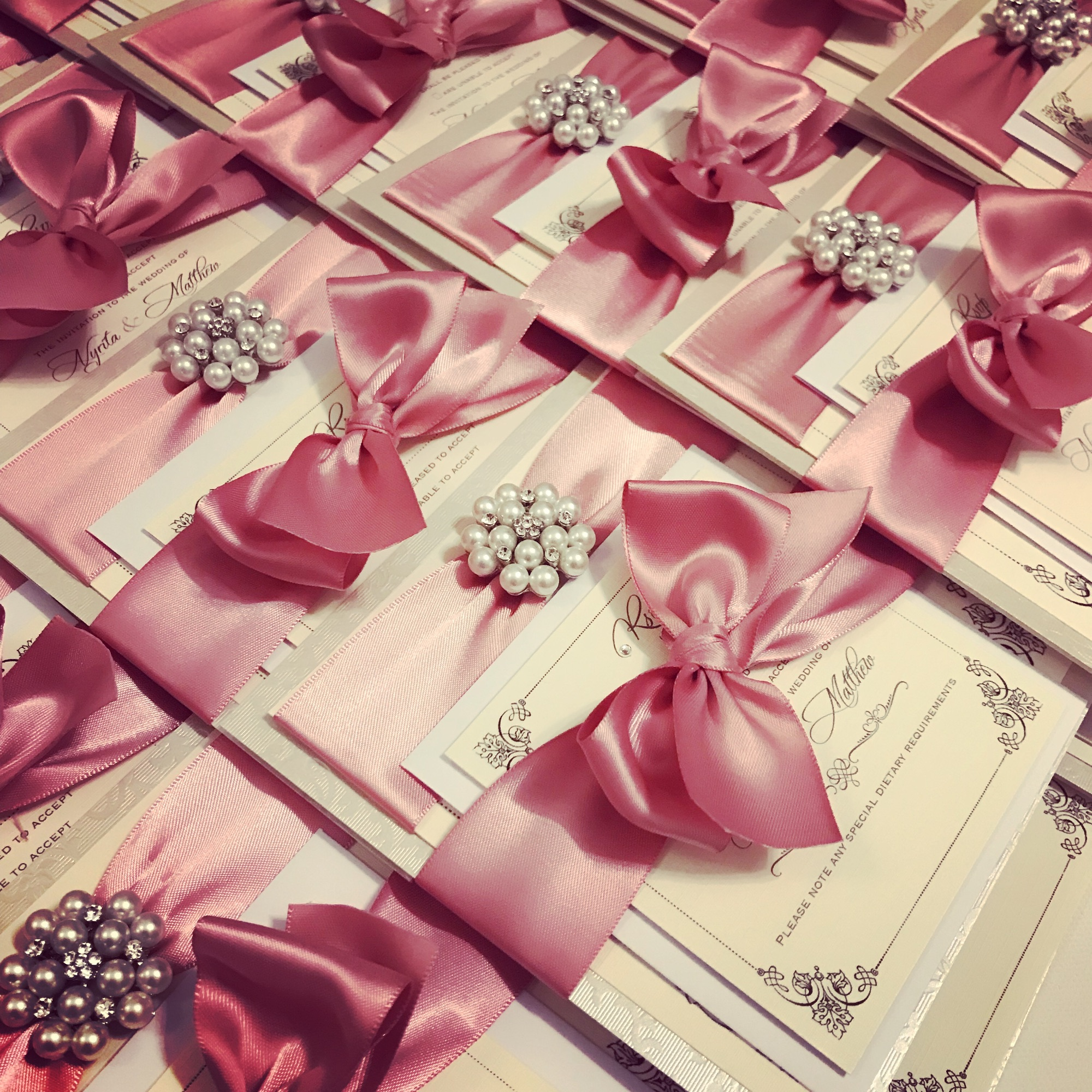 Pearl wedding invitations with bow