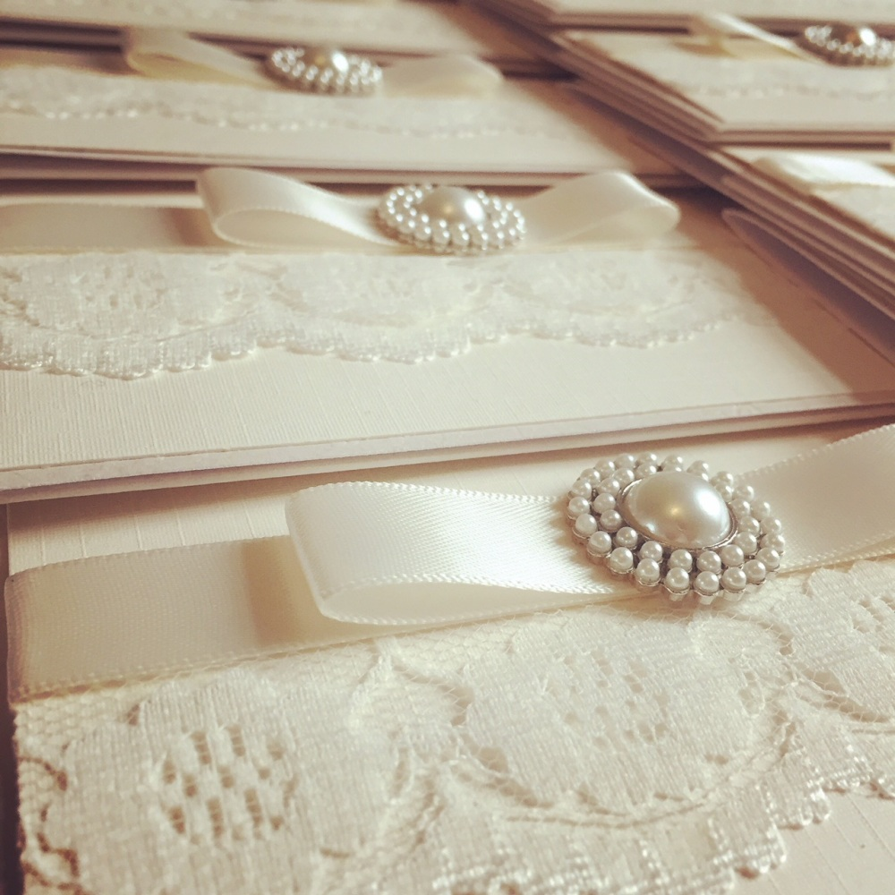 Luxury Lace wedding invitations decorated with lace and pearl brooch
