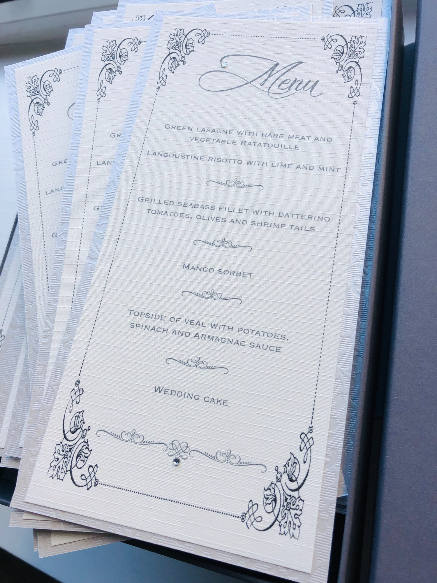 Plain wedding menus in ivory