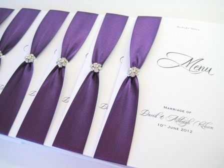 Wedding menu with purple ribbon and small diamante