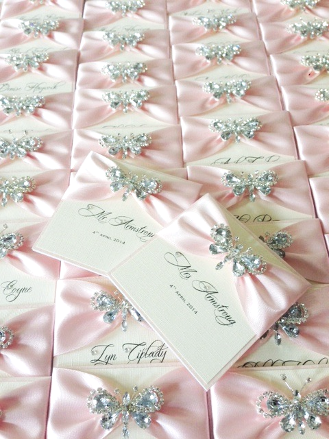 Butterfly place name cards with blush pink ribbon
