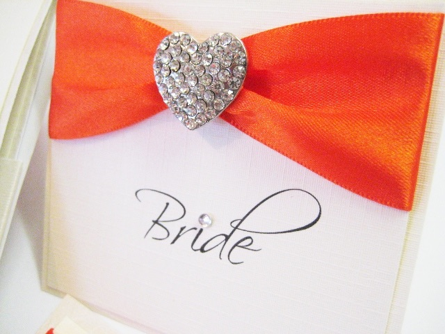 Place name setting with orange ribbon and diamante heart