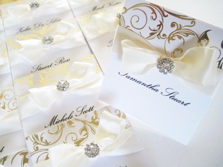 Luxury gold and white place name setting with bow and crystal