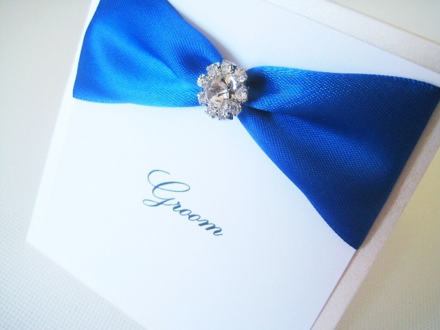 Place name card settings with royal blue ribbon