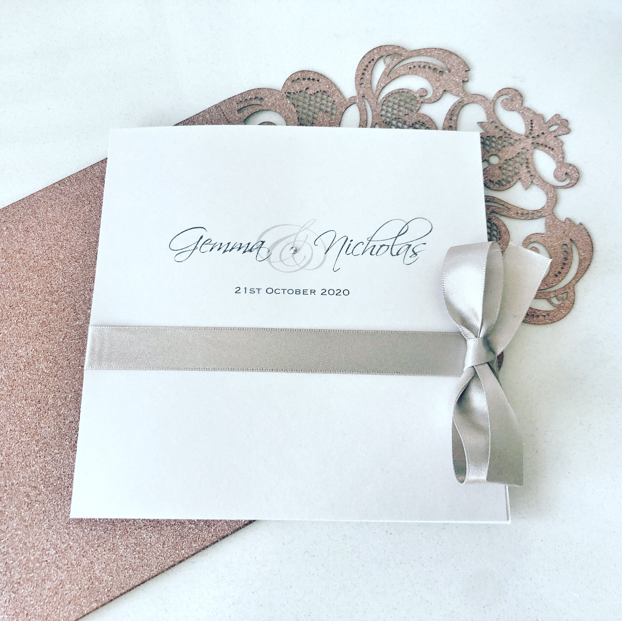 Pearlised wedding invitation with bow