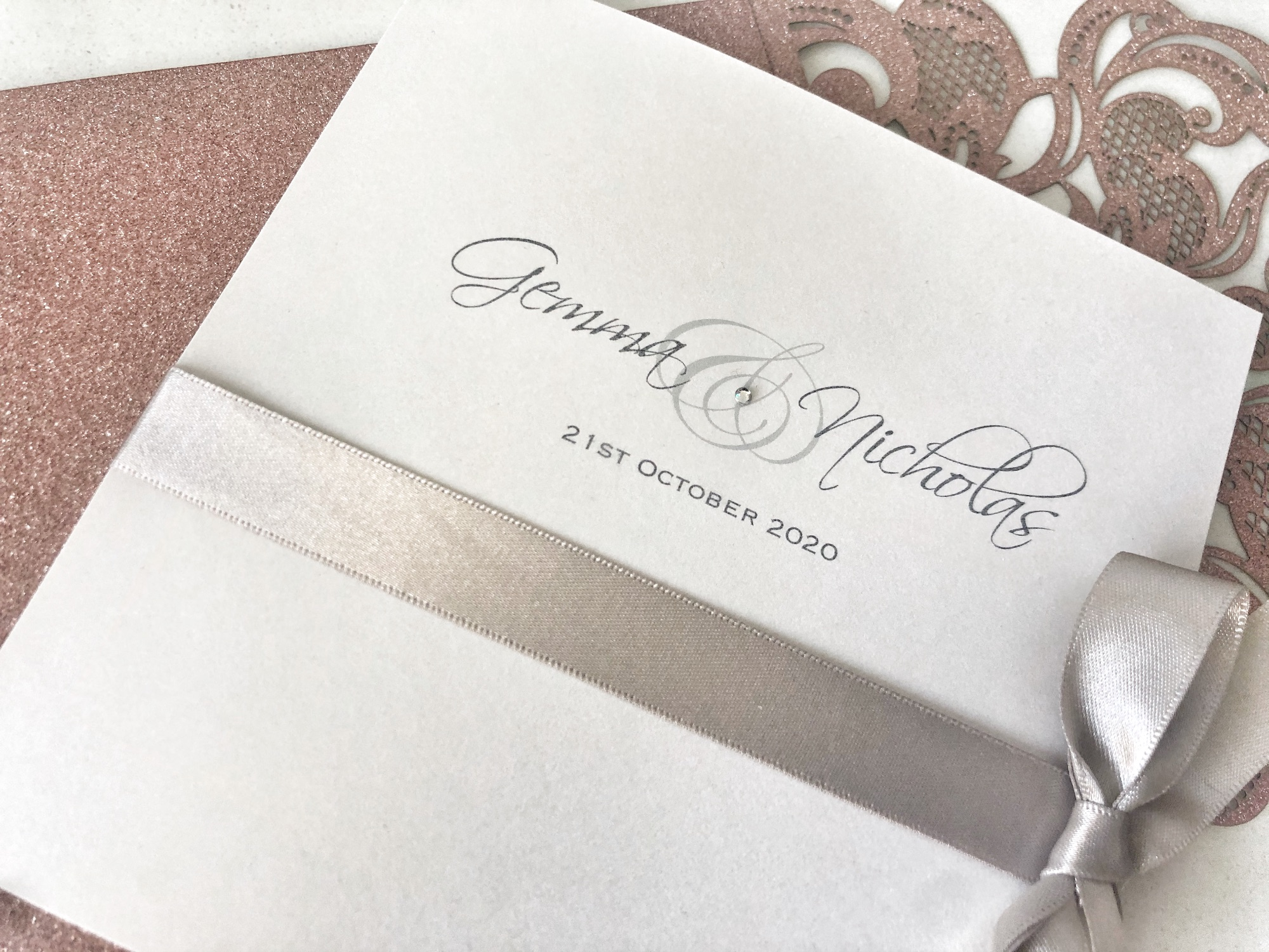 Pearlised ivory wedding invitation with hand tied bow