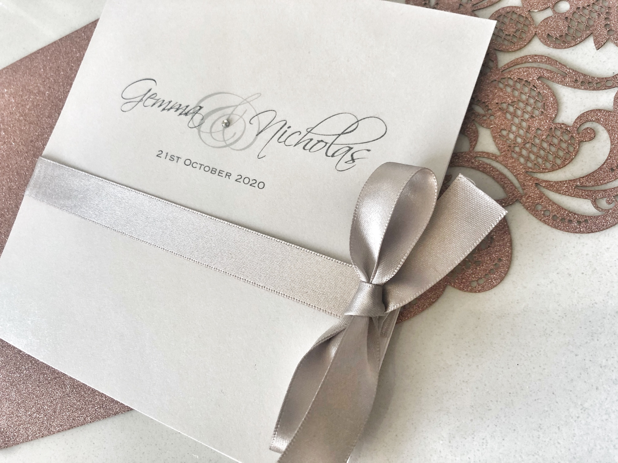 Elegant Silver and ivory wedding invitation with bow
